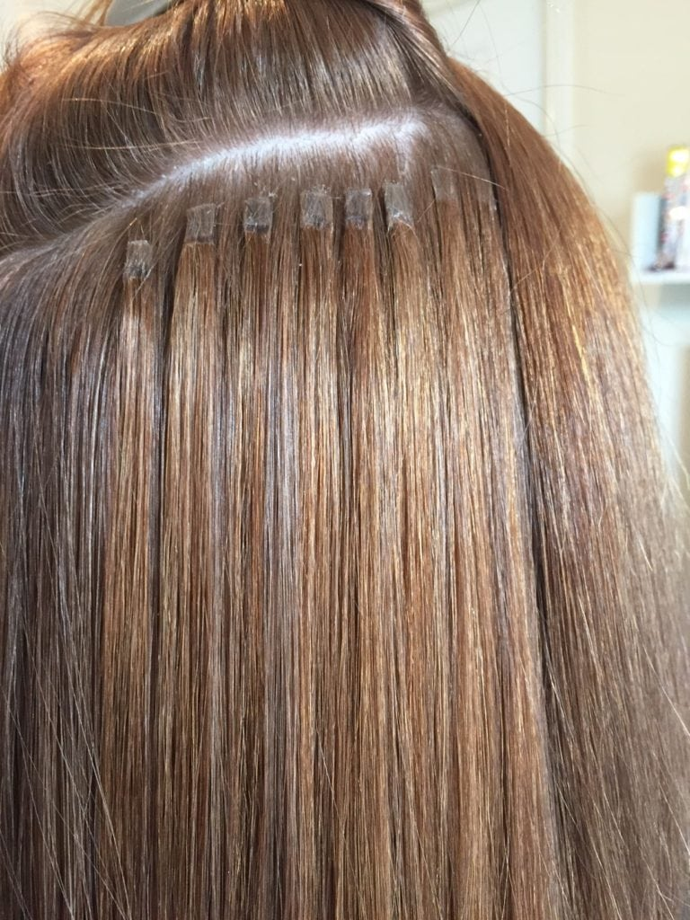 close up of hair extensions attached to hair