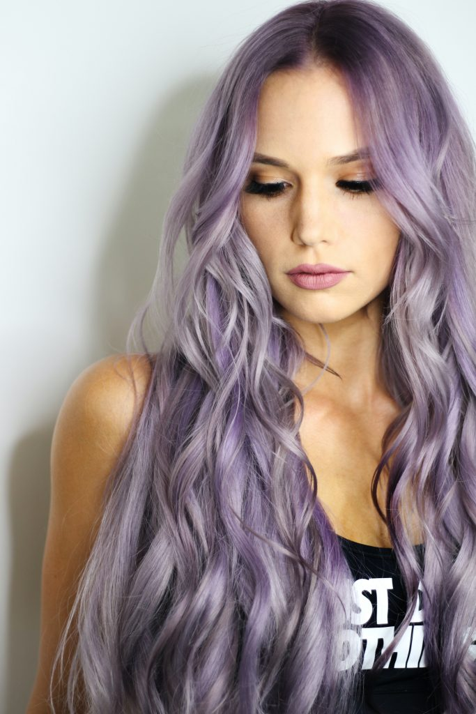Lady with long lilac mermaid wave hair extensions