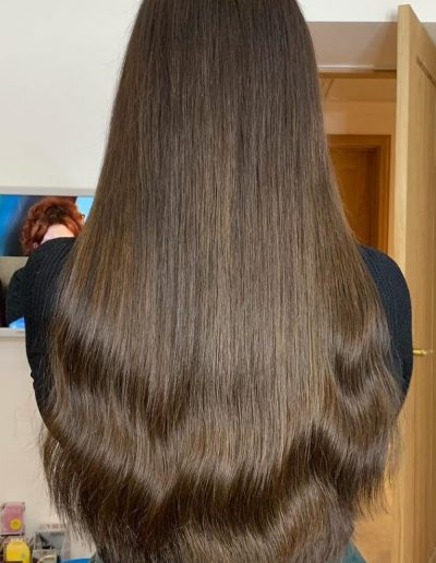 Very long brown hair extensions with loose curl