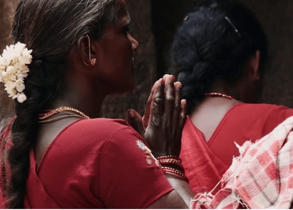 Indian women with long plaited hair